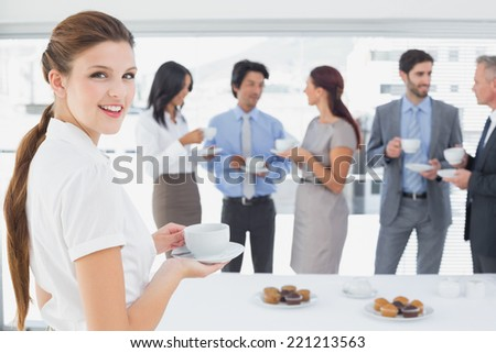 Business team enjoying their lunch in the office - stock photo