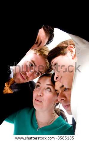 business team formed of businesswomen and business men working and thinking together - stock photo