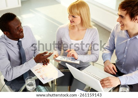 Business team gathering for discussion - stock photo