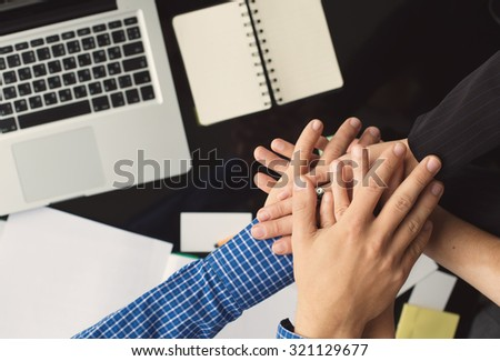 Business team Hands in office together. Desktop, notes and laptop on background - stock photo