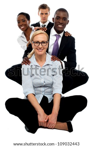 Business team having great time at work. Posing in line behind each other - stock photo