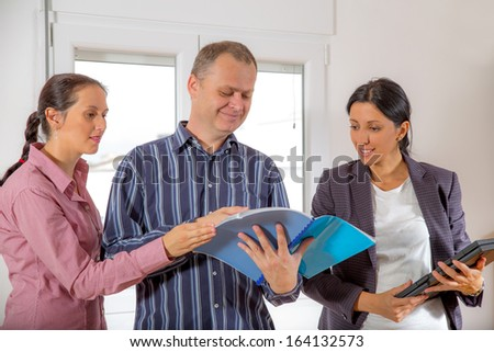 business team having informal meeting discussing a contract - stock photo
