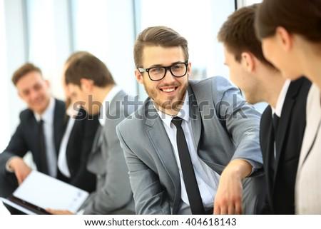 Business Team Having Informal Meeting In Office - stock photo