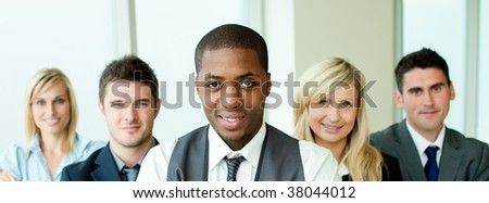 Business team in a row with ethnic manager in the center in office - stock photo