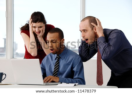 business team in an office on a laptop - stock photo
