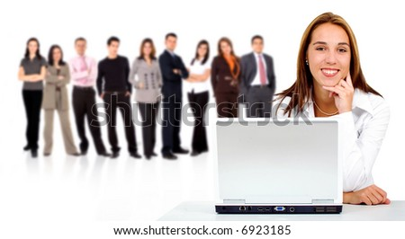 business team in the background with a businesswoman in an office laptop computer at the front - isolated over a white background - stock photo