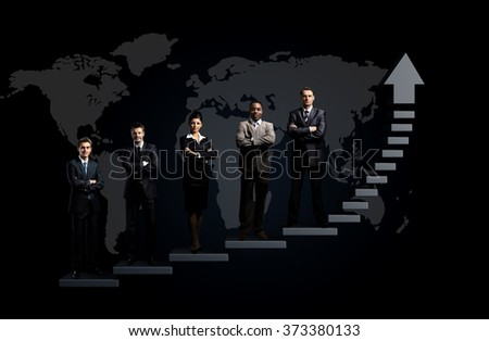 business team is standing on a graph - stock photo
