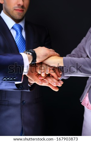 Business team joining hands - stock photo