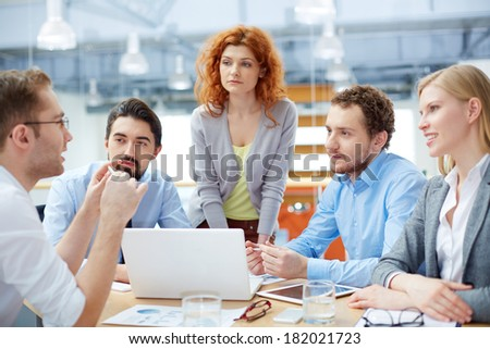 Business team listening to his leader with emphasis on a problem  - stock photo