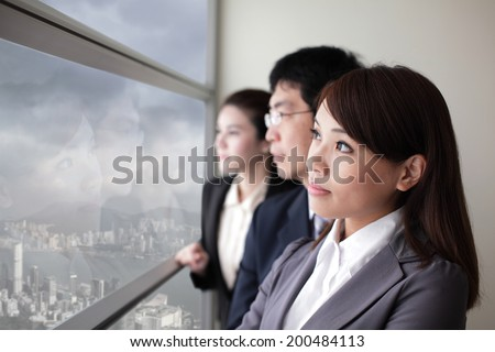 Business team look city and dark storm cloud through window with serious face, asia, hong kong, asian - stock photo