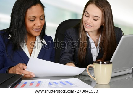 Business team looking at and analyzing data charts - stock photo
