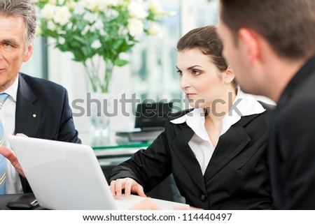Business - team meeting in an office, the boss with his employees - stock photo