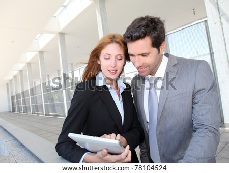 Business team meeting outside the airport - stock photo