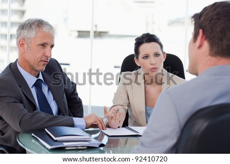 Business team negotiating with a customer in a meeting room - stock photo