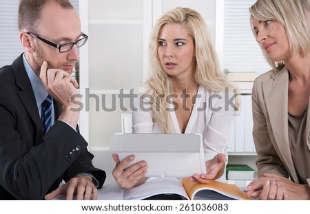 Business team of man and woman analyzing costs and finance. - stock photo