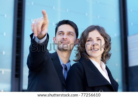 Business team over modern city background - stock photo