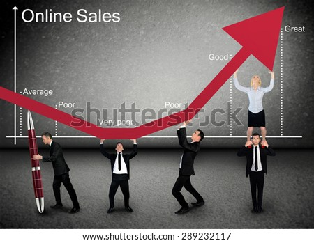 Business team push Online Sales graphic arrow up - stock photo