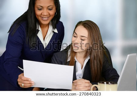Business team reading and analyzing data in the office - stock photo