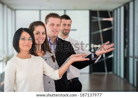 Business team showing a welcome gesture with hands - stock photo