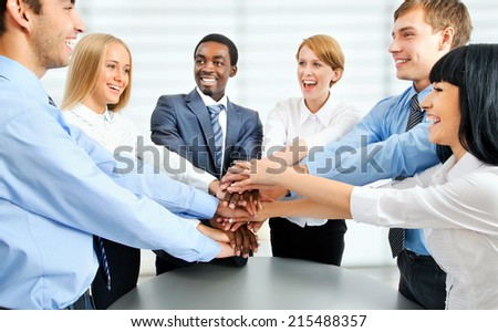 Business team showing unity with their hands together - stock photo