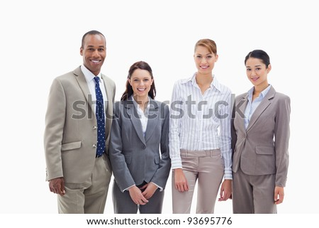 Business team smiling side by side against white background - stock photo