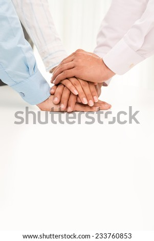 Business team stacking hands: teamwork concept - stock photo