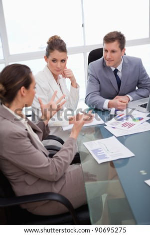 Business team talking about survey results - stock photo