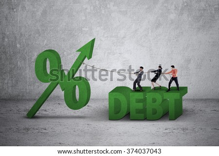 Business team using a rope to pull percentage symbol with upward arrow and debt word - stock photo