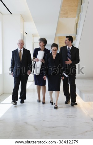 Business team walking to a planning meeting - stock photo