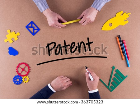 Business Team with a single word Patent - stock photo