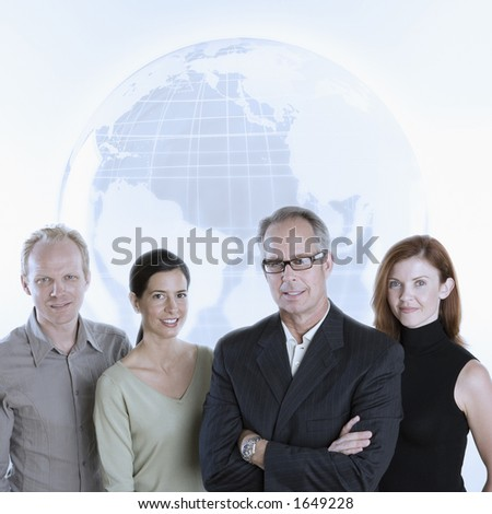 Business team with globe - stock photo