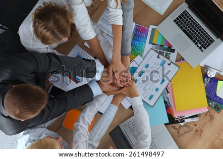 Business team with hands together - teamwork concepts. - stock photo