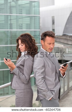 Business team with mobile phone - stock photo