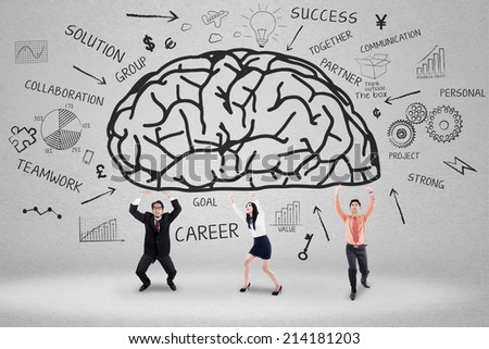 Business team with scribble holding a brain, symbolizing a big idea or creativity - stock photo