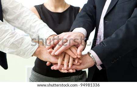 business team with their hands together - stock photo