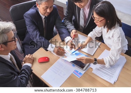 business  team work asian people report analysis  meeting discussing project planing shot over office working table - stock photo
