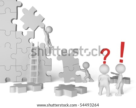business team work building a puzzle - stock photo