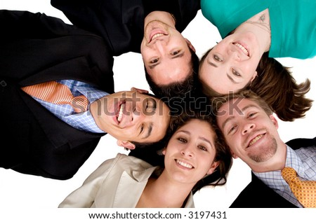 business team work - heads together over a white background - stock photo