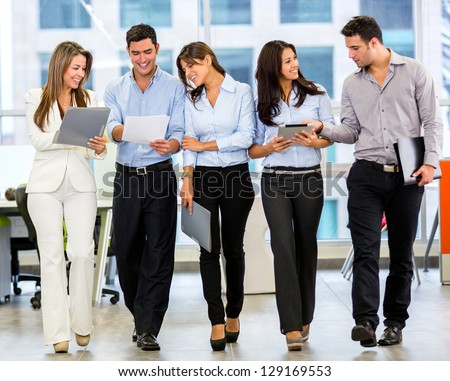 Business team working at the office looking very happy - stock photo