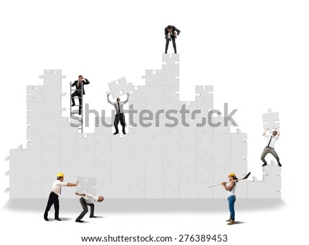 Business team working for the puzzle construction - stock photo