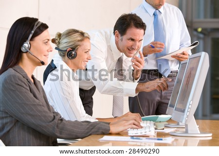 Business team working in office - stock photo