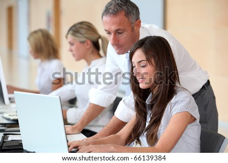 Business team working in the office on laptop computer - stock photo