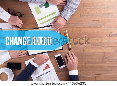 BUSINESS TEAM WORKING OFFICE CHANGE AHEAD DESK CONCEPT - stock photo