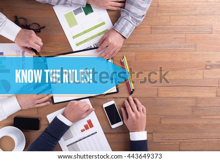 BUSINESS TEAM WORKING OFFICE KNOW THE RULES! DESK CONCEPT - stock photo