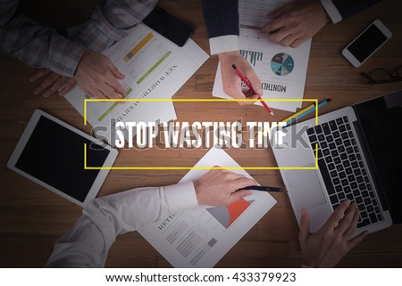 BUSINESS TEAM WORKING OFFICE  Stop Wasting Time TEAMWORK BRAINSTORMING CONCEPT - stock photo