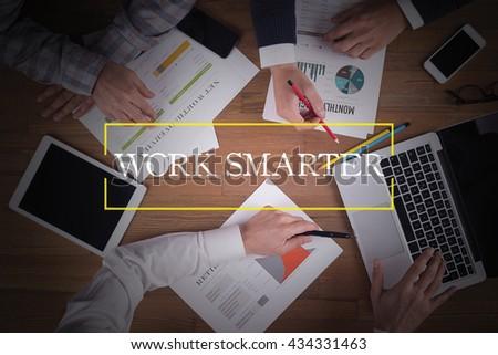 BUSINESS TEAM WORKING OFFICE  Work Smarter TEAMWORK BRAINSTORMING CONCEPT - stock photo