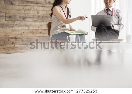 Business team working on a new plan with laptop. - stock photo