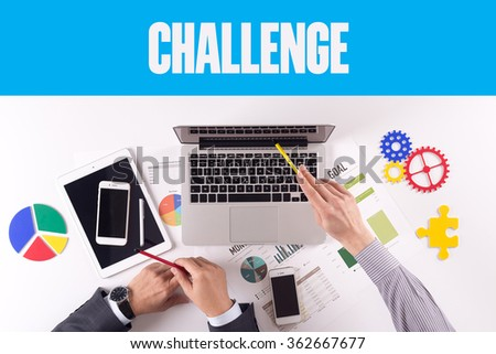 Business team working on desk with a single word CHALLENGE - stock photo