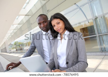Business team working on electronic tablet - stock photo