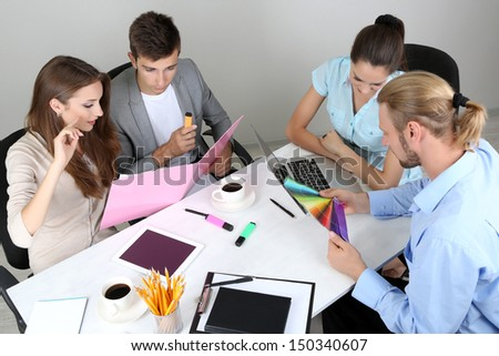 Business team working on their project together at office - stock photo